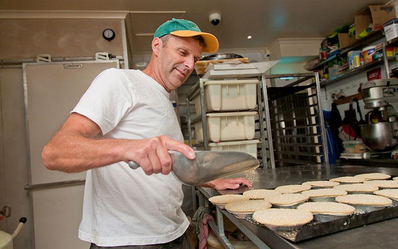 Mature man working in a kitchen